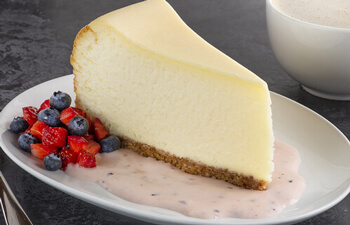 Cheesecake with Vanilla Sauce & Fresh Berries