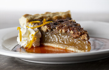 Chocolate Bourbon Pecan Pie with Citrus Honey Sriracha Sauce